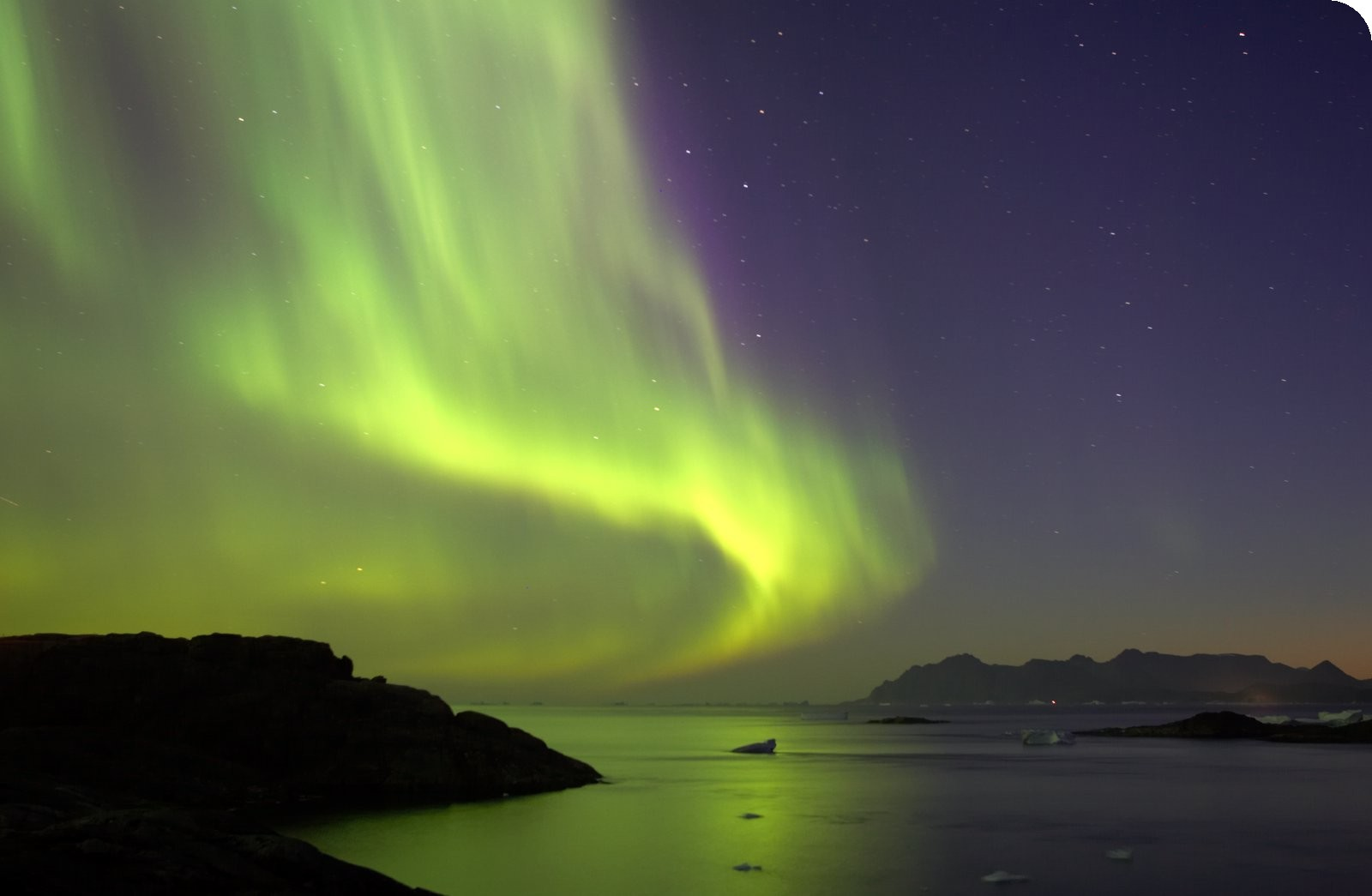 http://www.greenlandholiday.com/Portals/0/Photos/Northern%20Lights%20over%20the%20fjords.jpg