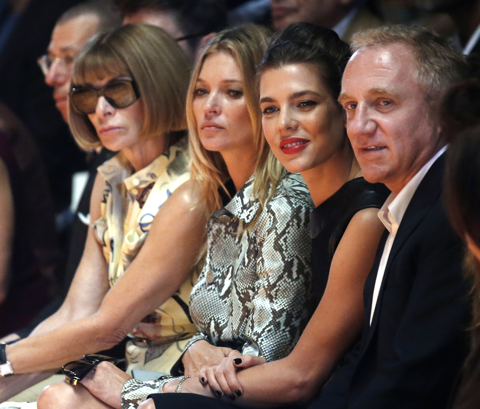 Anna Wintour, model Kate Moss, Princess Charlotte Casiraghi, and French businessman Francois Pinault attend Gucciwomen's spring-summer show, part of the Milan Fashion Week, unveiled in Milan, Italy, Wednesday, Sept. 17, 2014.